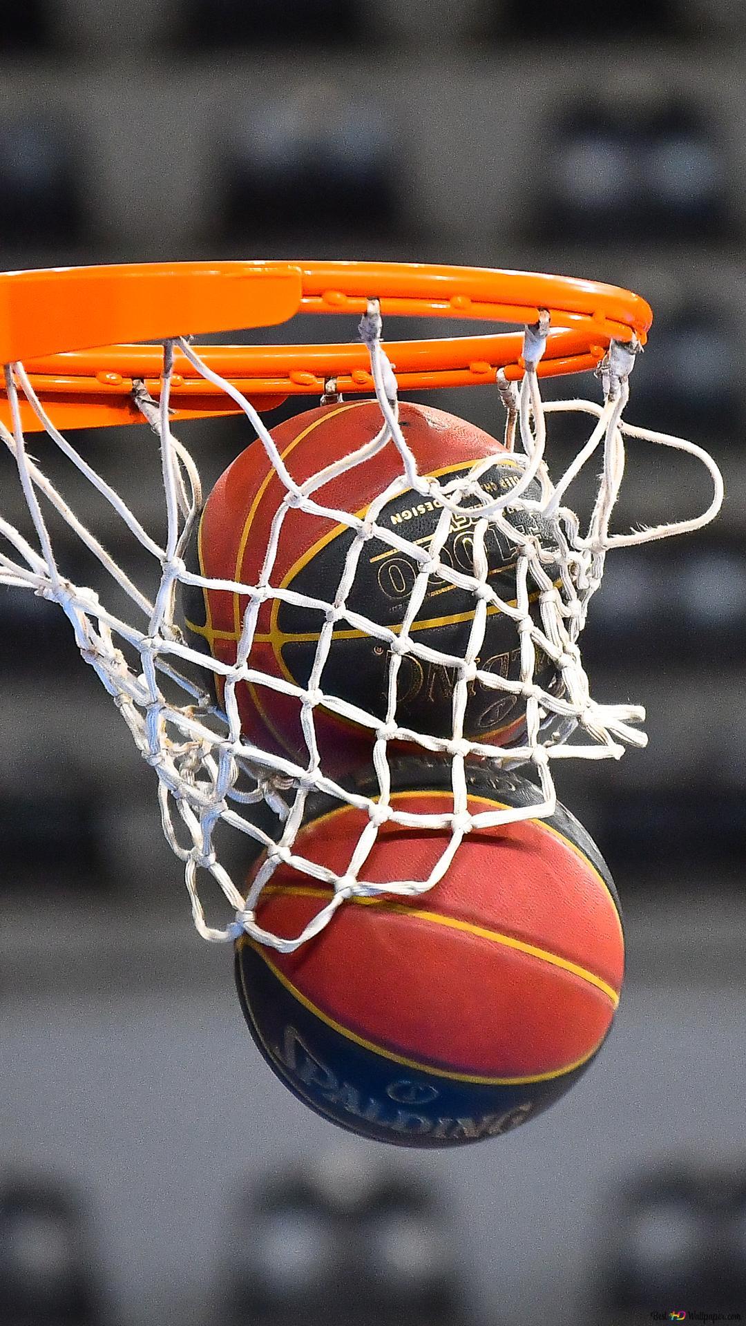 2つのボールはバスケットボールフープを通して落下します Hd壁紙のダウンロード