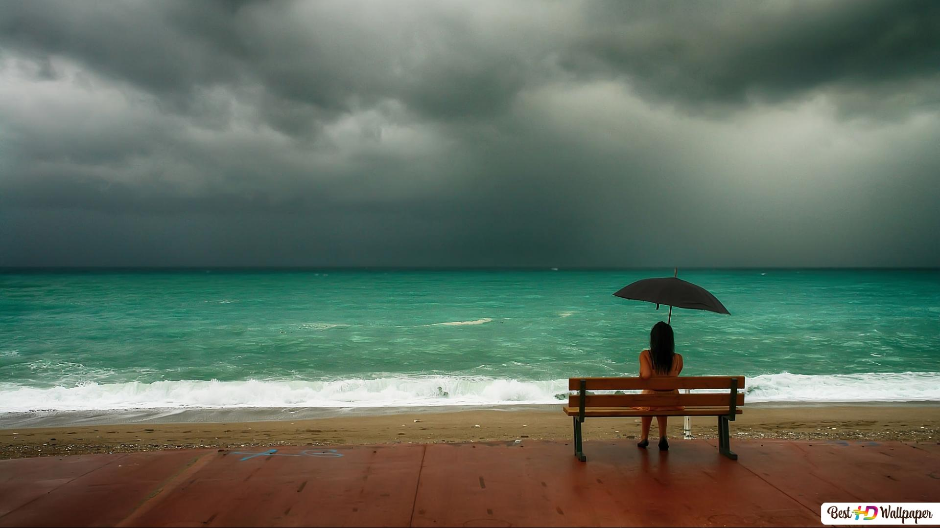 Lonely girl watching the ocean HD