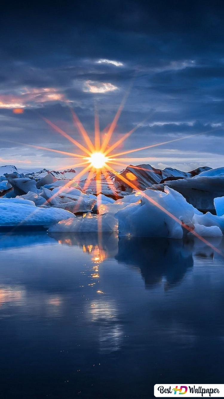 Sun Setting Over Icy Winter Ocean Hd Wallpaper Download