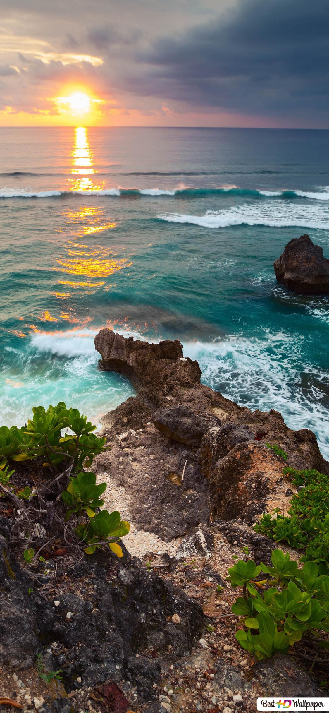 sunset over coast of indonesia wallpaper 1125x2436 27917 215