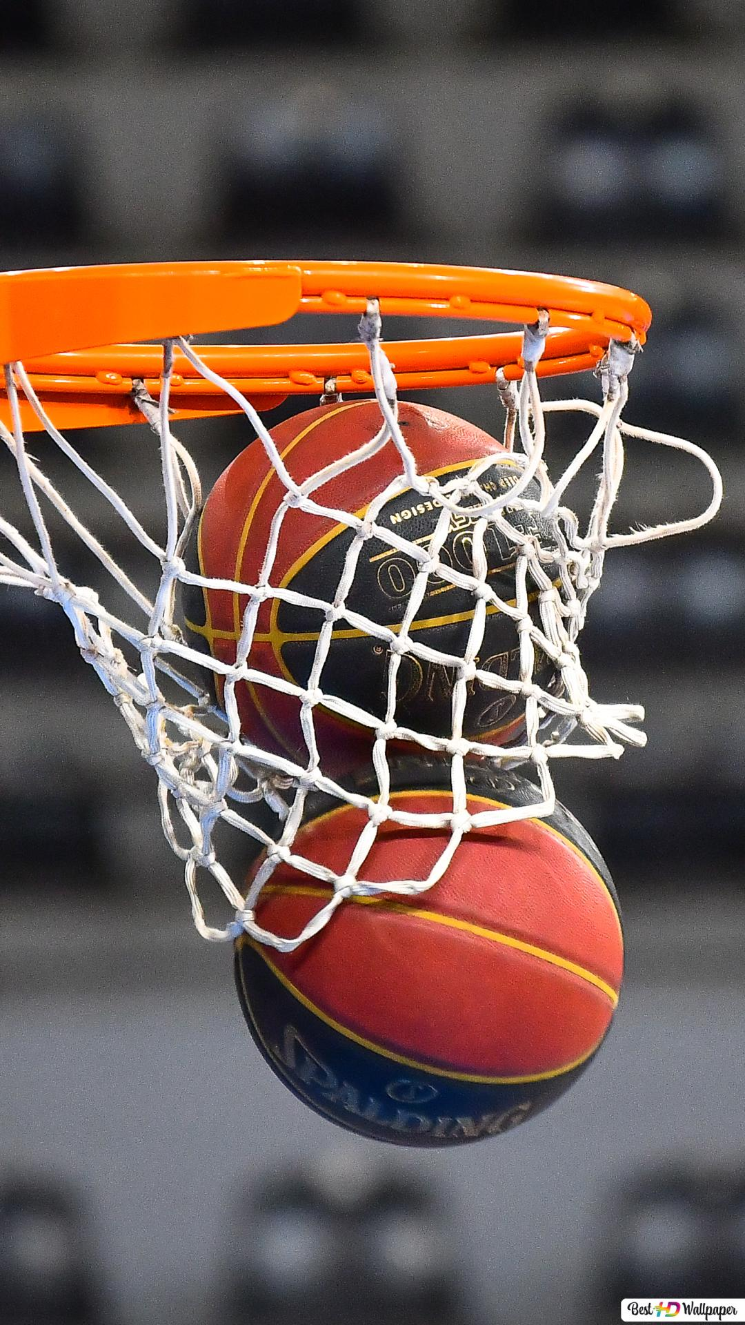 Two Balls Falling Down Through A Basketball Hoop Hd Wallpaper Download