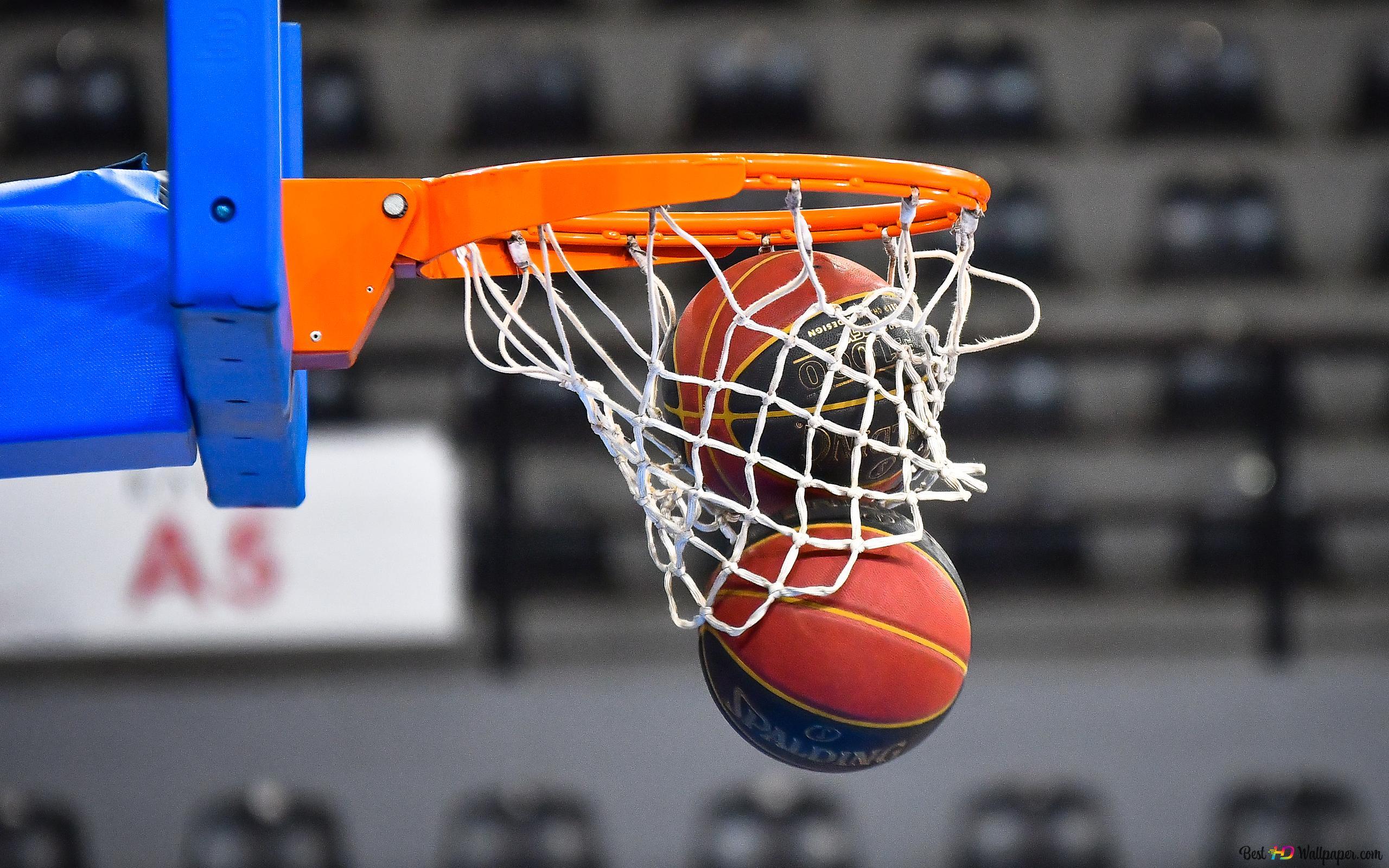 Two Balls Falling Down Through A Basketball Hoop Hd