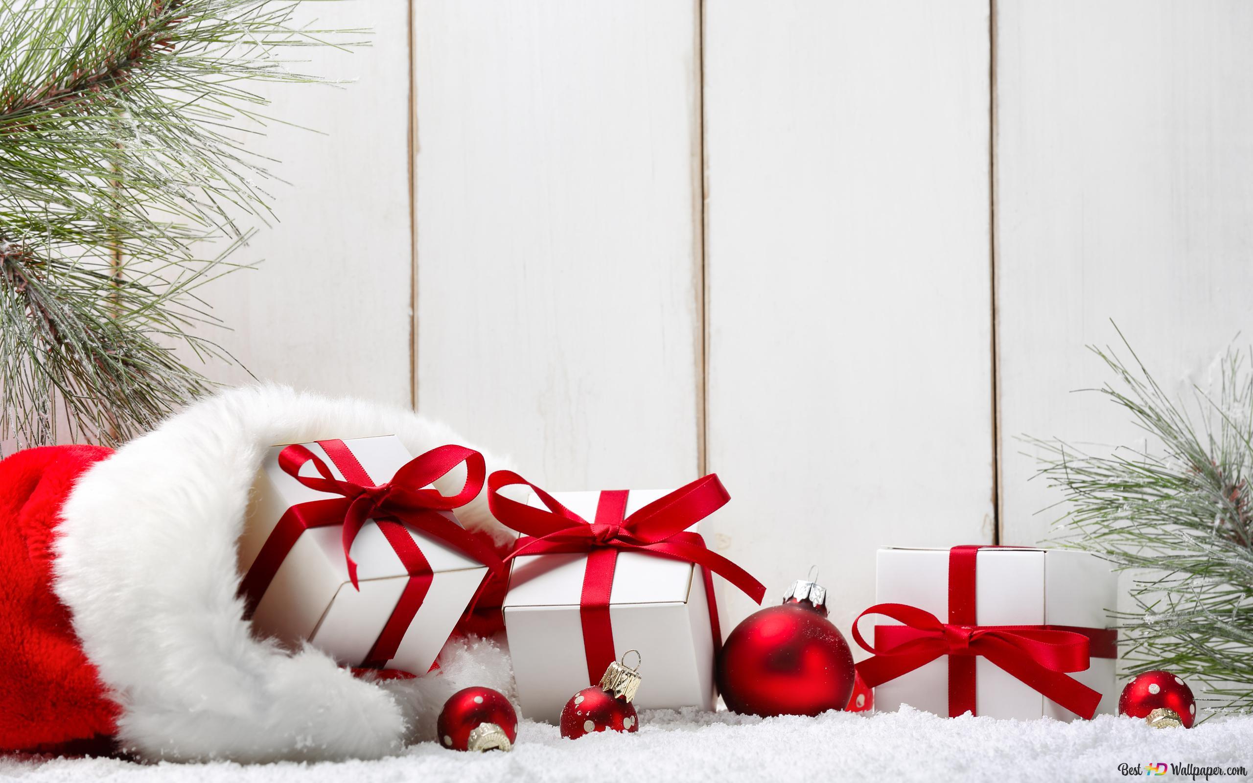 Weihnachtsgeschenke in roten Sack HD Hintergrundbilder herunterladen